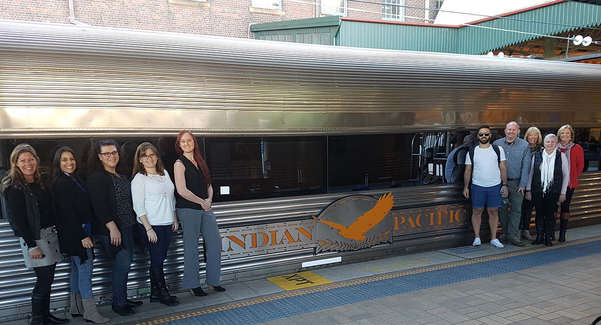 Team standing next to Indian Pacific